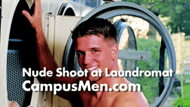 Photographing a naked male model at a laundromat