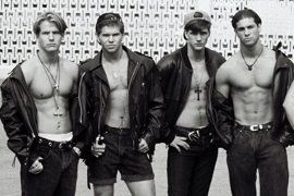 8 Male Models Pose in Leather Jackets for Photo